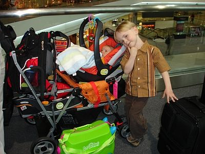 joovy-ultralight-with-base-backpack-in-airport-400