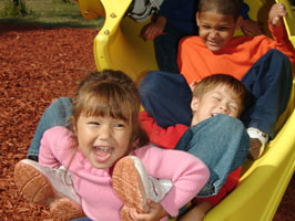 children playing on spiral slide