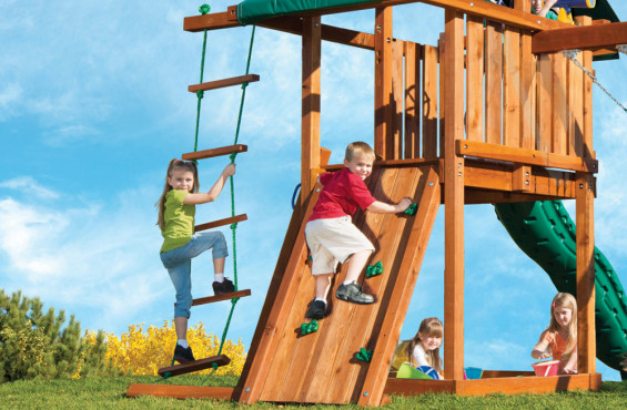 The climbing adventure starts on this side. The rock wall includes six climbing rocks and two safety assist handles to help kids grip their way to the top. The rope ladder will allow children to climb even further into the sky.