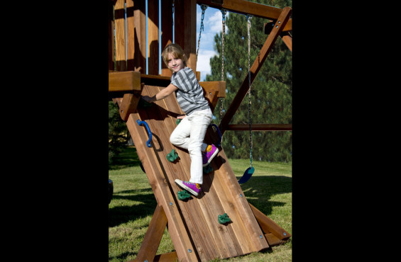 The journey to the play deck starts with the wide rock climbing wall. Rock wall includes safety handles and climbing rocks to help along the way.