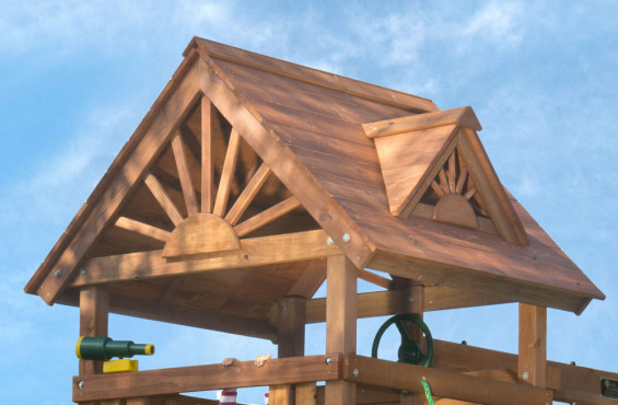 The beautiful cedar finish is highlighted on the gable-style roof with dormers. Underneath, children will adore the shade, swiveling telescope and steering wheel.