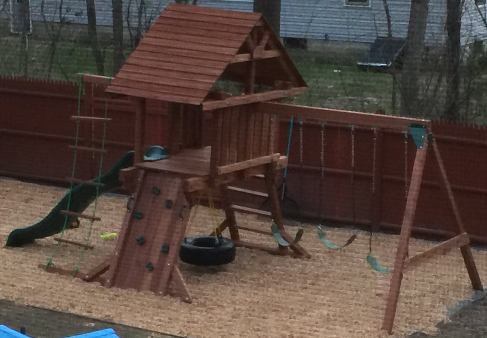 two ring backyard swing set with slide and wooden roof