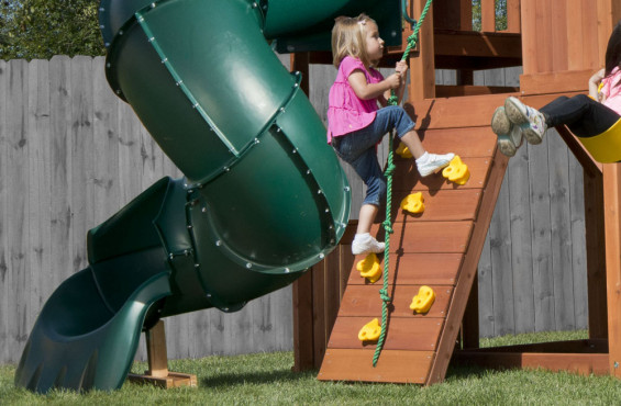 While there are two ways to reach the play deck, the rock climbing wall offers the most adventure. With each step, children will imagine themselves climbing the largest of mountains.